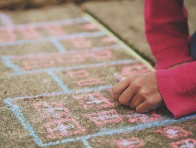 writing a math problem in chalk on a sidewalk